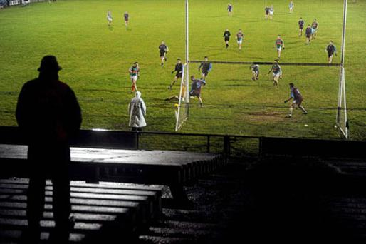 A lone fan stands on the terrace watching last Saturday's FBD Connacht League clash between Mayo and GMIT. The GAA will be hoping ticket price reductions will help to keep crowd numbers up for the league campaigns. Photo: Stephen McCarthy / Sportsfile