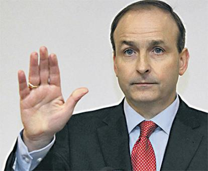 Foreign Affairs Minister Micheal Martin reveals he will not support the party leader in the vote