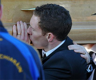 This was the heartbreaking moment when John McAreavey turned and gently kissed his young wife Michaela's coffin - for the last time. It was a moment of unbearable sorrow as his lips caressed the smooth cold surface of the wood.