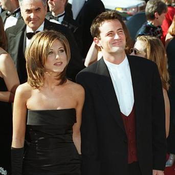 Jennifer Aniston, pictured with Friends co-star Matthew Perry in 1995, says 'the Rachel' haircut was 'ugly' (AP)