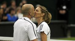 Andre Agassi kisses wife Steffi Graf at Wimbledon