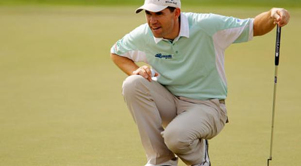 Padraig Harrington lines up a putt on the 18th green. Photo: Getty Images