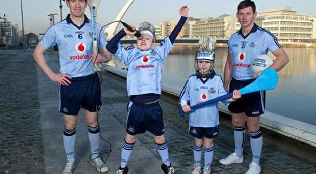 At the launch of the Dublin Spring Series are twins and Jedward fans Odhrán, left, and Ellen Ryan, aged 8, from Templeogue with Dublin hurler Joey Boland, left, and Dublin footballer Philly McMahon. The Series, starting on February 19, will consist of eight games being played at Croke Park; four football, two hurling, one camogie and one ladies football along with four music gigs all of which can be attended for just €45. Photo: Brendan Moran / Sportsfile