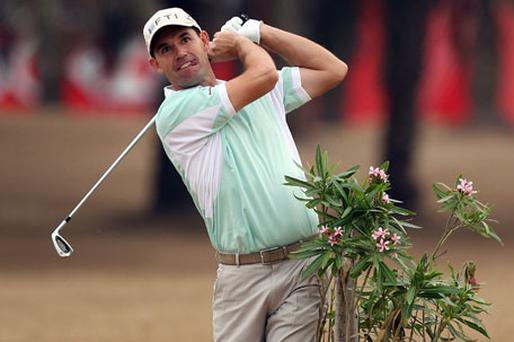 Padraig Harrington plays out of a hazard during the first round of the Abu Dhabi HSBC Golf Championship yesterday. Photo: Getty Images