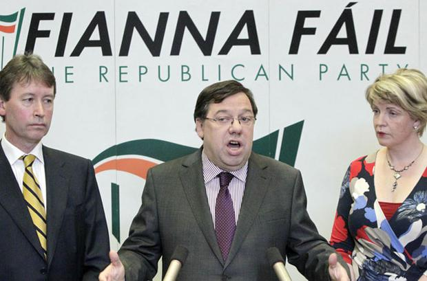 Brian Cowen with chief whip John Curran and Tanaiste & Minister for Education & Skills & Health & Children Mary Coughlan. Photo: PA