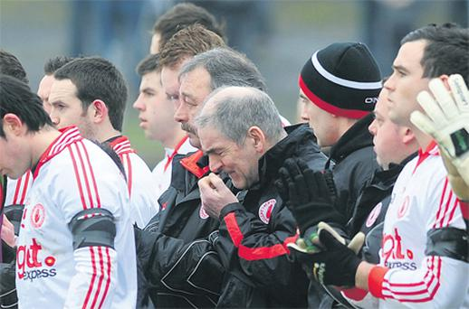 A distraught Mickey Harte during yesterday's minute's silence in memory of his daughter Michaela, who was murdered while on honeymoon in Mauritius