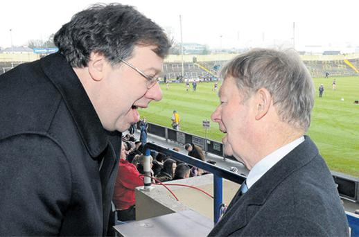 Taoiseach Brian Cowen chats with former RTE commentator Micheal O Muircheartaigh at yesterday's Leinster club football final in Portlaoise
