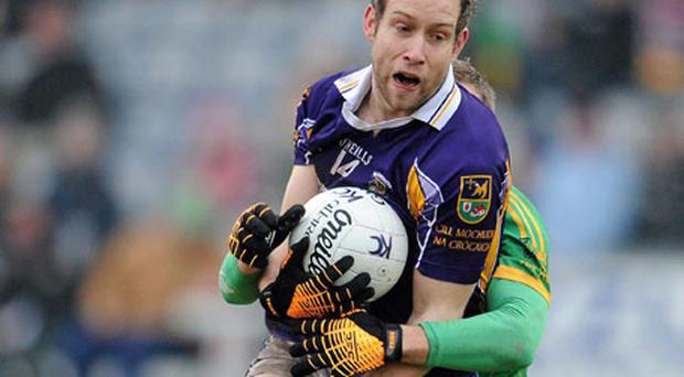 Brian Kavanagh of Kilmacud Crokes is tackled by Rhode's Shane Sullivan during yesterday's AIB Leinster SFC club Final at O'Moore Park, Portlaoise. Photo: Ray McManus / Sportsfile