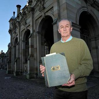 The Duke of Roxburghe with a 222-year-old letter written by poet Robert Burns, which was found in Floors Castle (Angus Blackburn)