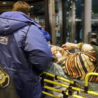 A man wounded in a terror blast is carried away at Domodedovo airport in Moscow (AP)