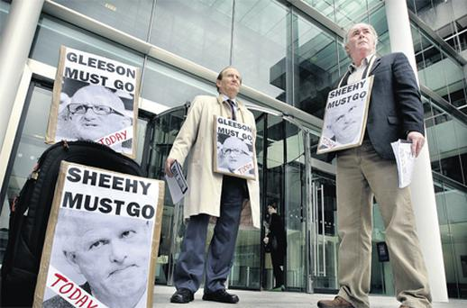Former employee Niall Murphy and Dave Johnstone, from the Campaign to restore Honesty & Integrity, protesting outside AIB bankcentre during the EGM in May 2009