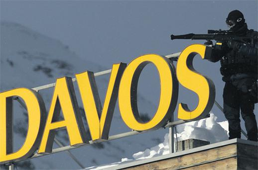 A member of the Swiss special police forces on the roof of the Congress Centre in Davos yesterday. The annual meeting of the World Economic Forum takes place under heavy security from today until Sunday. Photo: Reuters
