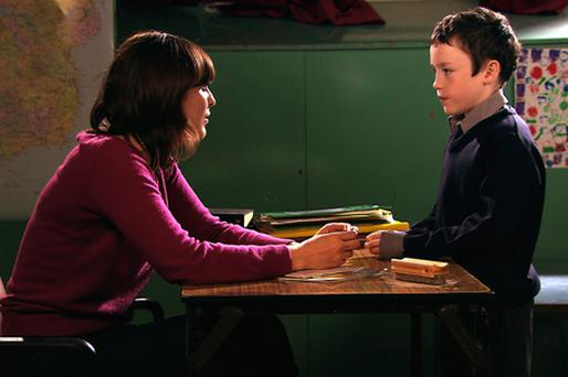 Oran Creagh is pictured in character as Ardal speaking to his teacher Miss Purdy, played by Olga Wehrly