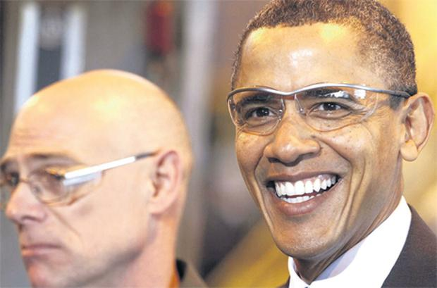 US President Barack Obama smiles as he tours an aluminum factory in Manitowoc, Wisconsin, as part of his 'White House to Main Street Tour'