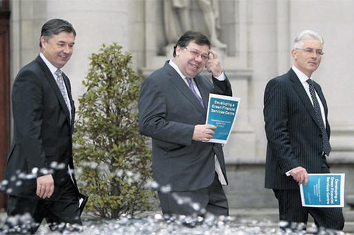 At Government Buildings yesterday for the launch were (from left): Padraig Rushe (BoI Corporate Banking), chair, IFSC Banking and Treasury Group; Taoiseach Brian Cowen; and David Guest (Ulster Bank), chair, IFSC Green Steering Group