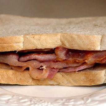 A man who weighs 20 stone is turning to bacon sandwiches to get even heavier in order to qualify for weight-loss surgery