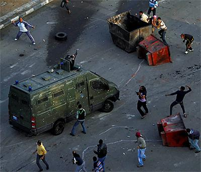 Egyptian police fire rubber bullets at anti-government protestors from armoured vehicles. Photo: Reuters