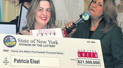 Yolanda Vega from the New York State Lottery presenting Irishwoman Trisha Eisel with a cheque for $21m on Thursday.