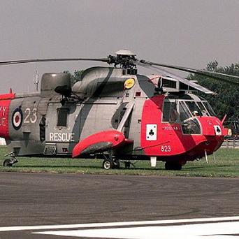 A Royal Navy Sea King helicopter rescued a climber who fell 1,000ft down Sgurr Choinnich Mor