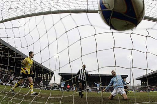Edin Dzeko fires home the equaliser for Manchester City against Notts County at Meadow Lane yesterday. Photo: Reuters