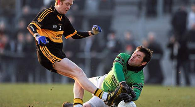 Nemo Rangers goalkeeper Brian Morgan produces a crucial save from Colm Cooper of Dr Crokes during yesterday's Munster Club SFC final. Photo: Barry Cregg / Sportsfile