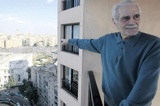 Egyptian film star Omar Sharif points to Tahrir, or Liberation, Square, in Cairo, Egypt, where hundreds of thousands of protesters have gathered to oppose President Hosni Mubarak