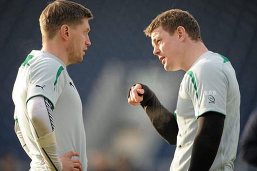Ireland's Ronan O'Gara and Brian O'Driscoll in conversation during training ahead of their Six Nations opener against Italy on Saturday. Photo: Barry Cregg / Sportsfile