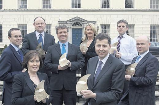 At the Ulster Bank Business Achievers Awards yesterday were (back row l-r) John Heffernan, Clearpower Ltd; Patrick McCarthy, Speedpak Ltd; Philip Tracey, Ace Express Freight; Fiona O'Sullivan, Sonru Ltd; Michael Burns, Helix Health Group; Chris Harmon, Country Crest; (front row l-r) Carolyn McAdam, Multihog Ltd; and Bernard McCauley, Grosvenor Cleaning Services