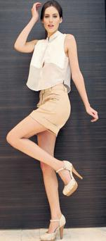 Model Isabel Traber wearing Philip Lim shorts (€255), an Acne white shirt (€230) and Carvela Acorn shoes (€185); LEON FARRELL/PHOTOCALL