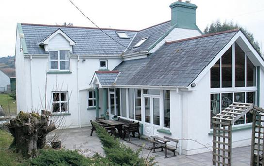 This four-bedroom house is being sold with 40ac of mixed grazing ground and forestry