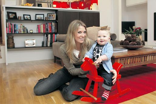 Tara and baby Dylan, whose rocking horse belonged to dad Andrew when he was a child