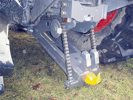 A hydraulic ram and chain is used to lower Dromone's new pick-up hitch