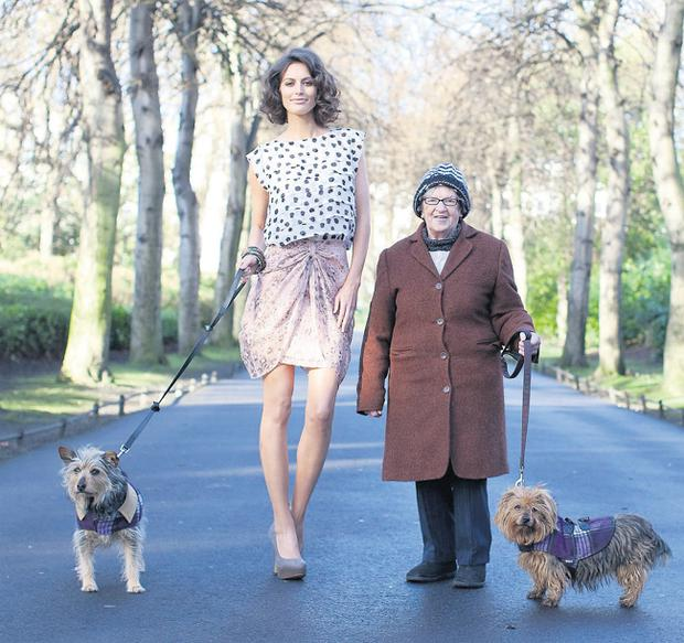 Isabelle Traber wearing a print top, €30, and draped skirt, €35, with Bridy Clemender and her dogs Trixy and Lilly in St Stephen's Green, Dublin. Photo: James Horan