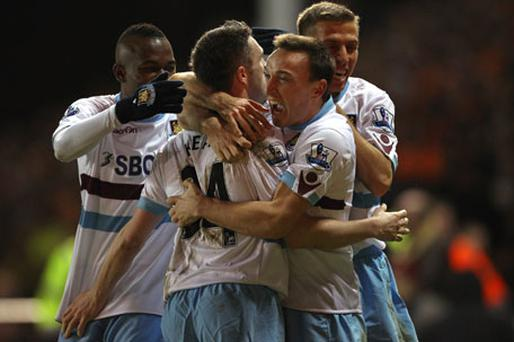 Robbie Keane celebrates with West Ham team-mate Mark Noble after scoring a debut goal against Blackpool in their Premier League clash at Bloomfield Road last night. West Ham won 3-1. Photo: Getty Images