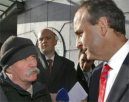 Fianna Fail leader Micheal Martin is confronted by an angry Tommy Hourihan in Galway yesterday