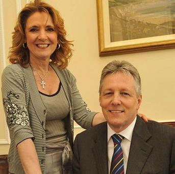 Iris Robinson, pictured with her husband Peter, has been fined for causing a road crash