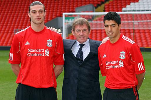 Liverpool manager Kenny Dalglish with new recruits Andy Carroll and Luis Suarez at Anfield yesterday. Photo: Getty Images
