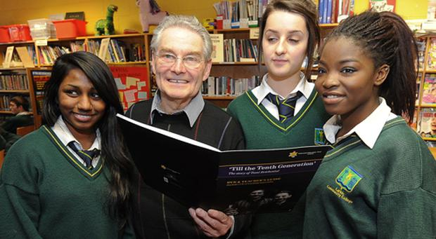 Concentration camp survivor Tomi Reichental with Larkin Community College students (from left) Fazire Zulkifli, Andrea Rus and Keji Ote
