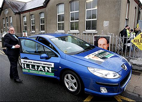 Fianna Fail's Nick Killian with his car parked on a double yellow line and displaying out-of-date insurance and NCT discs