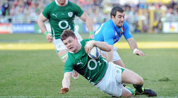 Brian O'Driscoll scores a try against Italy. Photo: Sportsfile