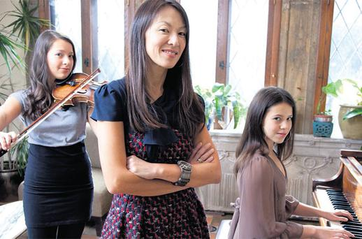 MUMMY KNOWS BEST: Amy Chua and daughters Lulu and Sophia at home in New Haven, Connecticut. Photo: Erin Patrice O'Brien for the Wall Street Journal