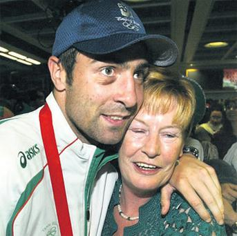Kenny Egan with his mother Maura just after he won silver in 2008. Photo: Martin Nolan