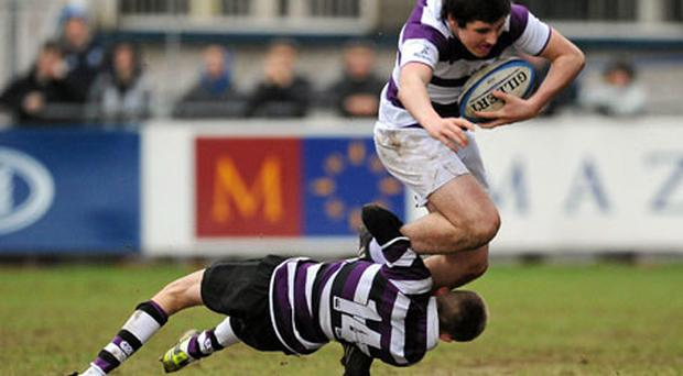 Cian O'Donoghue of Clongowes is tackled by Terenure's David Williams during yesterday's Leinster Schools Junior Cup first round clash at Donnybrook. Photo: Ray Lohan / Sportsfile