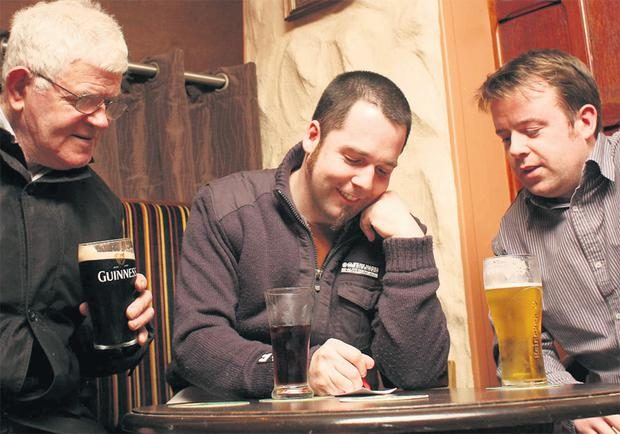 I know this one: Eddie Boyle, John Nolan and Ger Slattery at a Pub Quiz in Gilligan's Bar, Claremorris, Co Mayo. BRIAN FARRELL