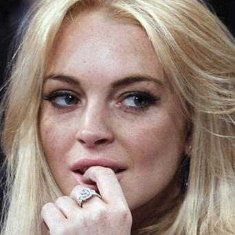 Lindsay Lohan's agent has denied she stole a £1,500 necklace