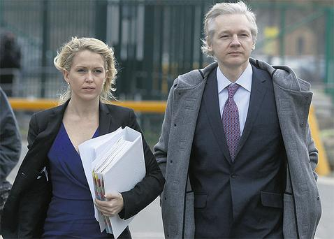 Julian Assange and lawyer Jennifer Robinson at Belmarsh magistrates' court in London yesterday