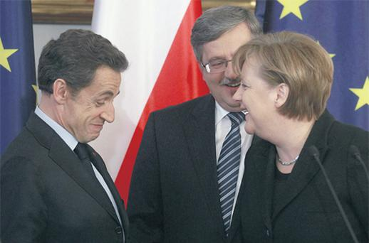 German Chancellor Angela Merkel, French President Nicolas Sarkozy and Polish President Bronislaw Komorowski (centre) smile as they chat during the Weimar Triangle summit in Warsaw, yesterday. Photo: Reuters
