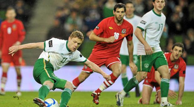 Damien Duff scores the second goal of the night against Wales - his first goal for Ireland in five years. Photo: David Maher / Sportsfile