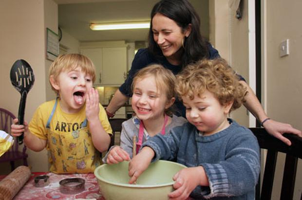 Can cook, will cook: Pictorial proof that Katie Gunn enjoys baking with her kids Marley, Kaya and Baxter. Photo: Ronan Lang