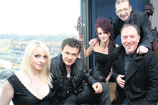 Don Mescal (second left) and band members Ann McCartney and Tanya O'Callaghan, with songwriter Ronan Hardiman (top right) and former Eurovision winner Paul Harrington at Windmill Lane Studios